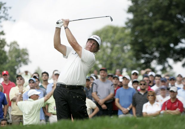 Phil Mickelson hits his tee shot from the seventh hole during the second round of The Barclays golf tournament, Friday, Aug. 26, 2011, in Edison, N.J.