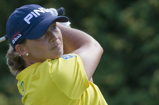 Angela Stanford, from the United States, tees off on the first hole during the LPGA Canadian Open women's golf tornament at the Hillsdale Golf Club in Mirabel, Quebec, Friday, Aug. 26, 2011.