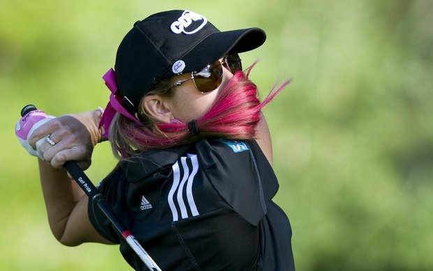 Paula Creamer from the United States tees off on the 10th hole during the second round of the Canadian Open women's golf tournament at the Hillsdale Golf Club in Mirabel, Quebec, Friday, Aug. 26, 2011.