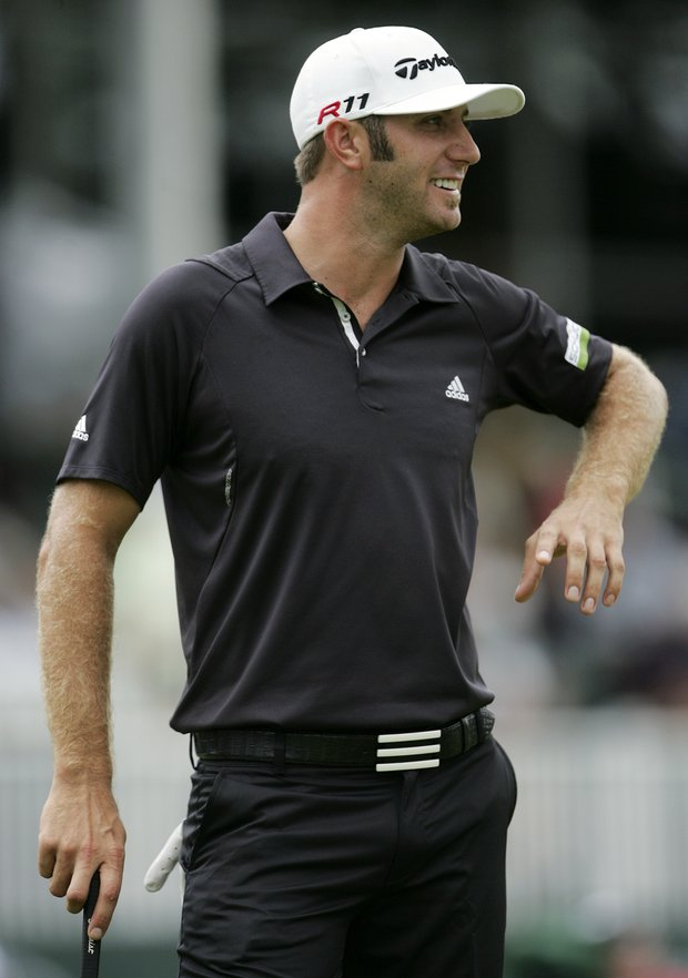 Dustin Johnson smiles after winning The Barclays golf tournament, Saturday, Aug. 27, 2011, in Edison, N.J.