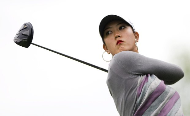 Michelle Wie, of United States, tees off on the third hole during the final round of the Canadian Women's Open golf tournament at Hillsdale Golf Club in Mirabel, Quebec, Sunday, Aug. 28, 2011.