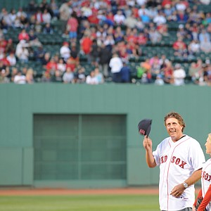 Phil Mickelson prepares to throw the first pitch at Fenway Park.