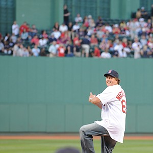 Phil Mickelson winds up for his opening pitch.