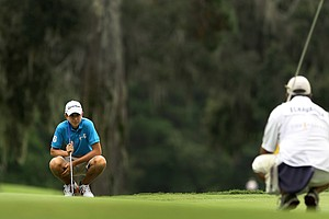 Nicolas Echavarria and his caddie line up a putt at the 2011 Junior Players at TPC Sawgrass in Ponte Vedra Beach, FL.