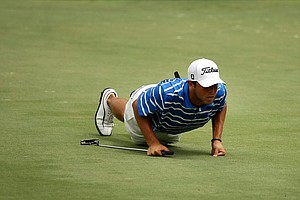 Jonathan Garrick gets low to read a putt at the 2011 Junior Players at TPC Sawgrass in Ponte Vedra Beach, FL.