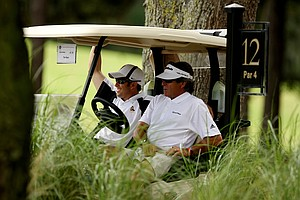 New head coach of Arizona State University, Tim Mickelson rides in a golf cart with Tim Huet of TaylorMade at the 2011 Junior Players at TPC Sawgrass in Ponte Vedra Beach, FL.