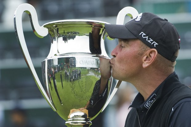 Thomas Bjorn from Denmark kisses the trophy after winning the Omega European Masters Golf Tournament in Crans Montana, Switzerland, Sunday, Sept. 4, 2011.