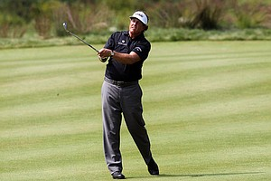Phil Mickelson watches his approach shot from the fairway on the 18th hole during the third round of the Deutsche Bank Championship at TPC Boston on September 4, 2011 in Norton, Massachusetts.