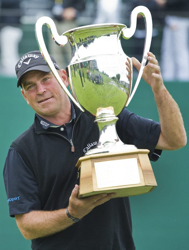 Thomas Bjoern from Denmark poses with the trophy after winning the Omega European Masters Golf Tournament in Crans Montana, Switzerland, Sunday, Sept. 4, 2011.