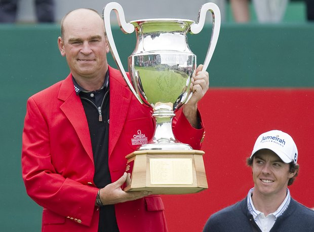 Thomas Bjoern from Denmark, left, holds the trophy next to Rory McIlroy of Northern Ireland, right, after winning the Omega European Masters Golf Tournament in Crans Montana, Switzerland, Sunday, Sept. 4, 2011.