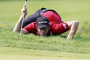 Camilo Villegas, of Columbia, lines up a putt on the 18th green during the third round of the Deutsche Bank Championship golf tournament at TPC Boston in Norton, Mass., Sunday, Sept. 4, 2011.
