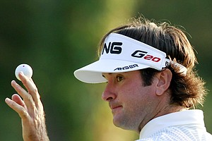 Bubba Watson gestures after sinking a putt on the 18th hole during the third round of the Deutsche Bank Championship golf tournament at TPC Boston in Norton, Mass., Sunday, Sept. 4, 2011. Watson finished in first place, 11-under par.