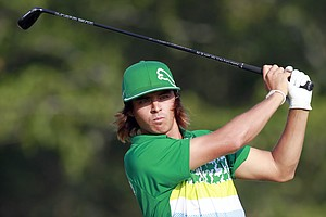 Rickie Fowler tees off on the 17th hole during the third round of the Deutsche Bank Championship golf tournament at TPC Boston in Norton, Mass., Sunday, Sept. 4, 2011.