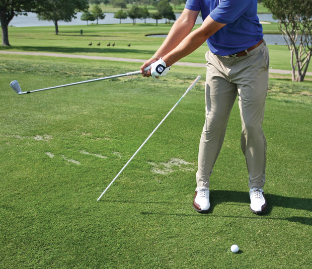 Spieth uses an alignment stick to prevent his right hip from sliding on the backswing.