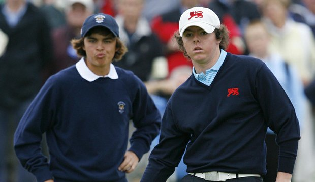 Great Britian and Ireland golfer Rory McIlroy, right, follows his putt on the 14th green as Rickie Fowler of the USA looks on during the final day of the 2007 Walker Cup.