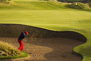 Kelly Kraft (USA) plays from a greenside bunker on the 16th hole as seen during a the afternoon singles round at the 2011 Walker Cup at Royal Aberdeen Golf Club in Aberdeen on Saturday, Sept. 10, 2011.