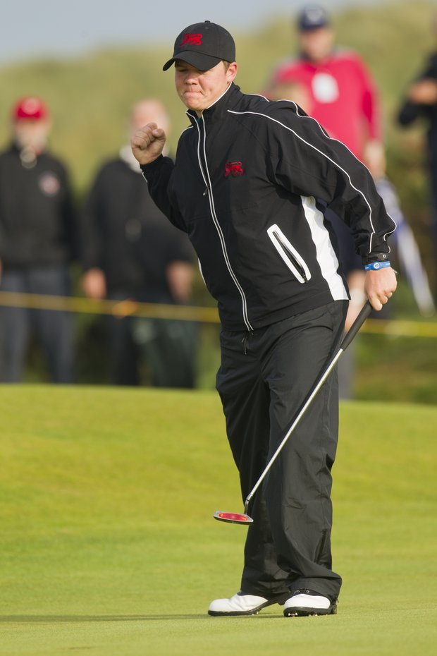 Rhys Pugh (GB&I) reacts to his made putt on the 14th hole as seen during a the afternoon singles round at the 2011 Walker Cup at Royal Aberdeen Golf Club in Aberdeen on Saturday, Sept. 10, 2011.