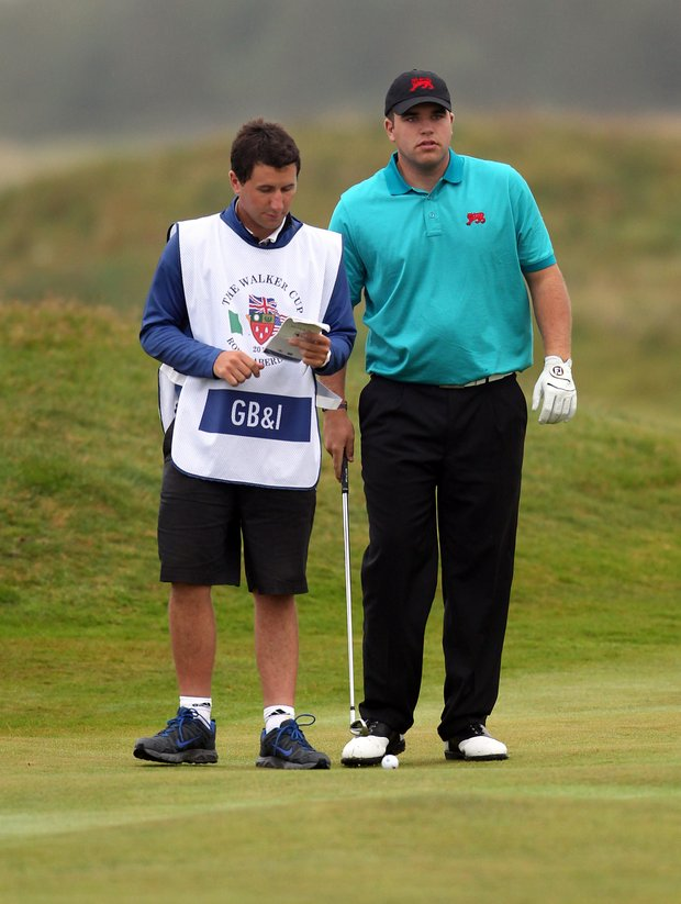 Jack Senior of Great Britain and Ireland with his caddy, Joe Senior, during the day one morning foursomes matches of the 2011 Walker Cup held on the Balgownie Links at Royal Aberdeen Golf Club on September 10, 2011 in Aberdeen, Scotland. Joe Senior is no longer on his brother's bag after his professional golf status was brought to light, a rule violation. Jack Senior and partner Andy Sullivan won their match, and the victory was upheld because the rule violation was not revealed until after the victory was declared.