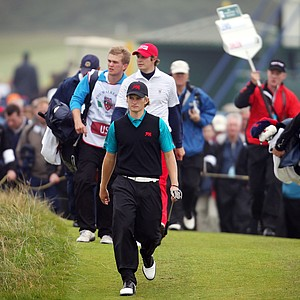 Tom Lewis of Great Britain and Ireland walks down the fairway during the day one afternoon singles matches of the 2011 Walker Cup held on the Balgownie Links at Royal Aberdeen Golf Club on September 10, 2011 in Aberdeen, Scotland.