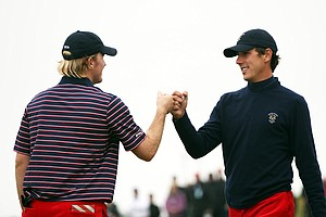 Russell Henley and Kelly Kraft of the USA celebrate winning the forth hole during the day one morning foursomes matches of the 2011 Walker Cup held on the Balgownie Links at Royal Aberdeen Golf Club on September 10, 2011 in Aberdeen, Scotland. Henley and Kraft would lose the match.