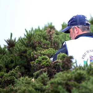 A caddy looks for Tom Lewis' lost ball on the first hole during the Day 1 morning foursomes matches of the 2011 Walker Cup held on the Balgownie Links at Royal Aberdeen Golf Club on September 10, 2011 in Aberdeen, Scotland.