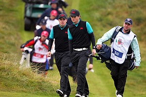 Paul Cutler and Alan Dunbar of Great Britain and Ireland walk down the fairway during the day one morning foursomes matches of the 2011 Walker Cup held on the Balgownie Links at Royal Aberdeen Golf Club on September 10, 2011 in Aberdeen, Scotland. They would beat Nathan Smith and Blayne Barber, 5 and 4.