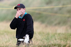 Stiggy Hodgson of Great Britain and Ireland looks distressed during the day one morning foursomes matches of the 2011 Walker Cup held on the Balgownie Links at Royal Aberdeen Golf Club on September 10, 2011 in Aberdeen, Scotland. Hodgson and partner Steven Brown would fall to Patrick Cantlay and Chris Williams, 5 and 3.