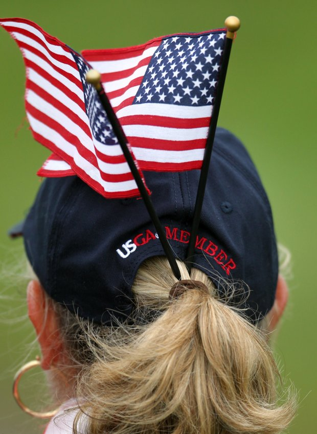 A USGA team member shows her support for the USA team by wearing stars and stripes flags in her hair during the day one morning foursomes matches of the 2011 Walker Cup held on the Balgownie Links at Royal Aberdeen Golf Club on September 10, 2011 in Aberdeen, Scotland.