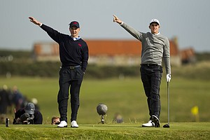 Michael Stewart (GB&I), left, and Patrick Rodgers (USA) point to Rodgers' tee shot on the 12th hole as seen during the morning foursomes round at the 2011 Walker Cup at Royal Aberdeen Golf Club in Aberdeen on Sunday, Sept. 11, 2011.