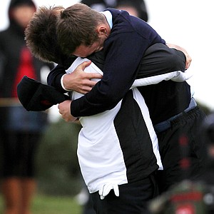 Micheal Stewart of Great Britain and Ireland celebrates with teammate Andy Sullivan after he wins his singles match on Day 2 of the 2011 Walker Cup held on the Balgownie Links at Royal Aberdeen Golf Club on September 11, 2011 in Aberdeen, Scotland.