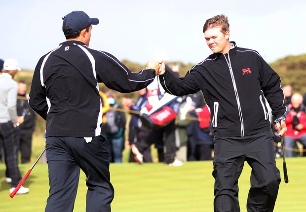 James Byrne and Rhys Pugh of Great Britain and Ireland celebrates after sinking a putt on No. 16 during the Day 2 morning foursomes matches of the 2011 Walker Cup held on the Balgownie Links at Royal Aberdeen Golf Club on September 11, 2011 in Aberdeen, Scotland. Byrne and Pugh would go on to win their match.