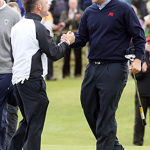 Andy Sullivan and Jack Senior of Great Britain and Ireland congratulate each other after securing victory on No. 17 during the Day 2 morning foursomes matches of the 2011 Walker Cup held on the Balgownie Links at Royal Aberdeen Golf Club on September 11, 2011 in Aberdeen, Scotland.