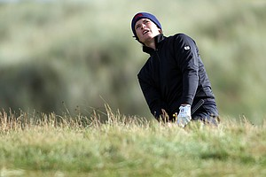 Tom Lewis of Great Britain and Ireland plays out of the rough during the Day 2 morning foursomes matches of the 2011 Walker Cup held on the Balgownie Links at Royal Aberdeen Golf Club on September 11, 2011 in Aberdeen, Scotland. Lewis and partner Michael Stewart would halve their match with Jordan Spieth and Patrick Rodgers.