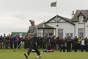 Jordan Spieth (USA) reacts to his made putt on the 18th hole as seen during the morning foursomes round at the 2011 Walker Cup at Royal Aberdeen Golf Club in Aberdeen on Sunday, Sept. 11, 2011.