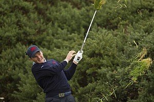 Michael Stewart (GB&I) plays the third shot on the 18th hole during the morning foursomes round at the 2011 Walker Cup at Royal Aberdeen Golf Club in Aberdeen on Sunday, Sept. 11, 2011.