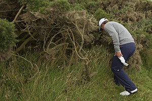 Blayne Barber (USA) looks for the USA tee shot on the 12th hole as seen during the morning foursomes round at the 2011 Walker Cup at Royal Aberdeen Golf Club in Aberdeen on Sunday, Sept. 11, 2011.