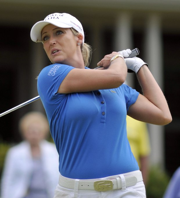 Cristie Kerr watches her shot off the 17th tee during the second round of the LPGA NW Arkansas Championship golf tournament in Rogers, Ark., Saturday, Sept. 10, 2011.