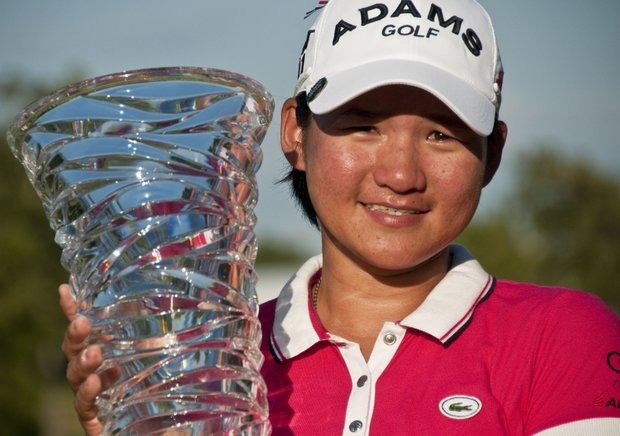 Yani Tseng poses with the NW Arkansas Championship trophy after winning the LPGA golf tournament in Rogers, Ark., Sunday, Sept. 11, 2011. Tseng won in a playoff with South Korea's Amy Yang.