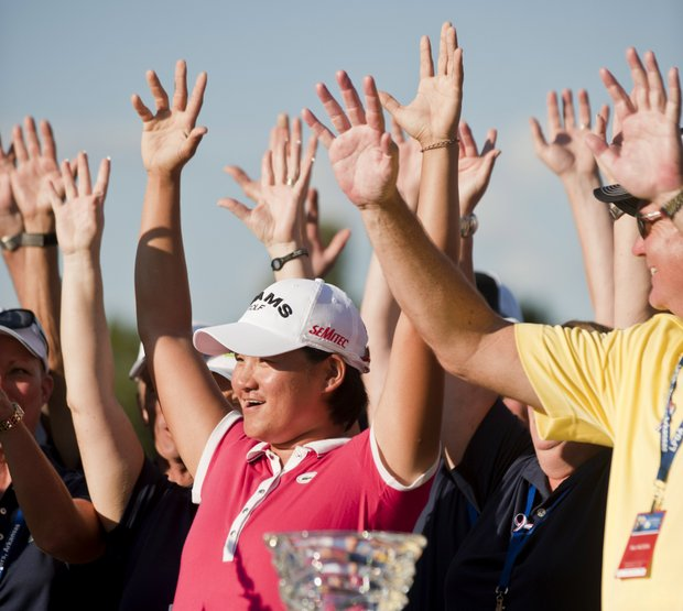 "Yani Tseng, of Taiwan, ""calls the hogs"" after winning the LPGA NW Arkansas Championship golf tournament on Sunday, Sept. 11, 2011, in Rogers, Ark."