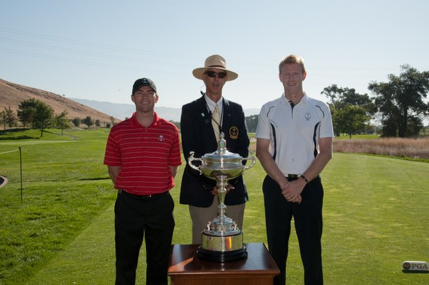 U.S. team member Marty Jertson (left), referee Scott Essig and GB&I team member Craig Goodfellow pose with the trophy before their singles match at the 25th PGA Cup at CordeValle in San Martin, Calif.