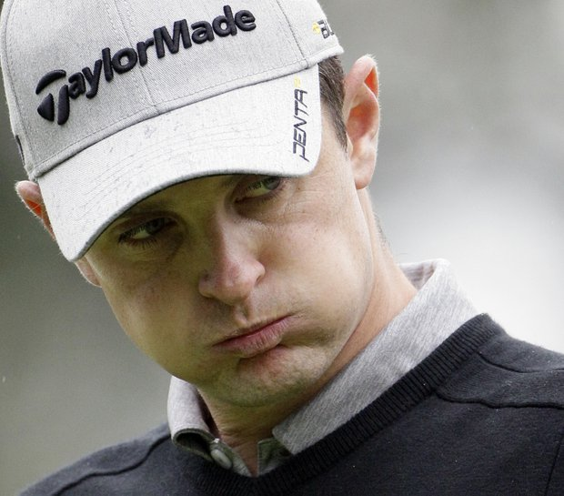 Justin Rose reacts as he reads the green on the fourth hole during the final round of the BMW Championship golf tournament Sunday.