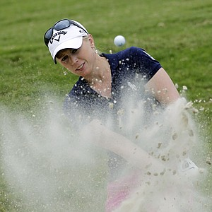 Morgan Pressel hits from the sand on the 18th green during the first round of the Navistar LPGA Classic golf tournament at Capitol Hill on the Robert Trent Jones Golf Trail in Prattville, Ala., Thursday, Sept. 15, 2011.