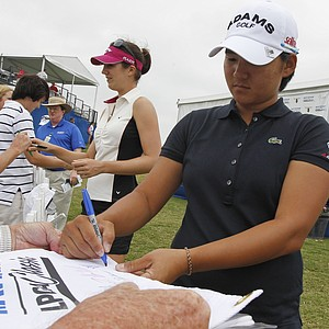 Yani Tseng, right, and Sandra Gal of Germany sign autographs following their first round of the Navistar LPGA Classic golf tournament at Capitol Hill on the Robert Trent Jones Golf Trail in Prattville, Ala., Thursday, Sept. 15, 2011.