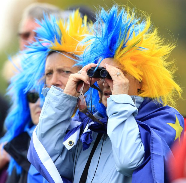 Supporters of team Europe watch the players on the 12th tee during the foursomes matches on Day 1 of the The Solheim Cup at Killeen Castle Dunsany near Dublin, Ireland on September 23, 2011.