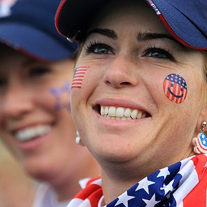 Paula Creamer, right, of the U.S. smiles with teammate Brittany Lincicome, left, after winning their match during the foursomes match with Karen Stupples and Melissa Reid of Europe on Day 1 of the The Solheim Cup at Killeen Castle Dunsany near Dublin, Ireland, on September 23, 2011.
