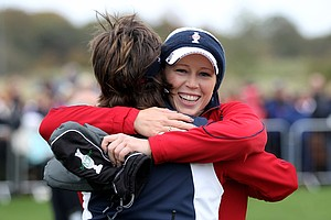 Morgan Pressel of the U.S. embraces captain Rosie Jones following her victory with partner Paula Creamer on the 18th green during the afternoon four-ball play on Day 1 of the 2011 Solheim Cup at Killeen Castle Golf Club on September 23, 2011 in Dunshaughlin, County Meath, Ireland.