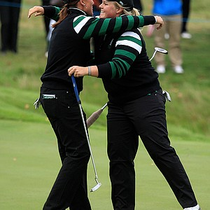 Sophie Gustafson of Europe embraces Caroline Hedwall, right, on the 14th green following their victory during  afternoon four-ball play on Day 1 of the 2011 Solheim Cup at Killeen Castle Golf Club on September 23, 2011 in Dunshaughlin, County Meath, Ireland.