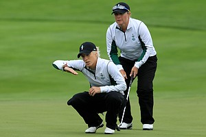 Melissa Reid and Karen Stupples of Europe line up a putt during the morning foursomes on Day 1 of the 2011 Solheim Cup. The European duo would end up losing their match to Paula Creamer and Brittany Lincicome on the 18th hole.