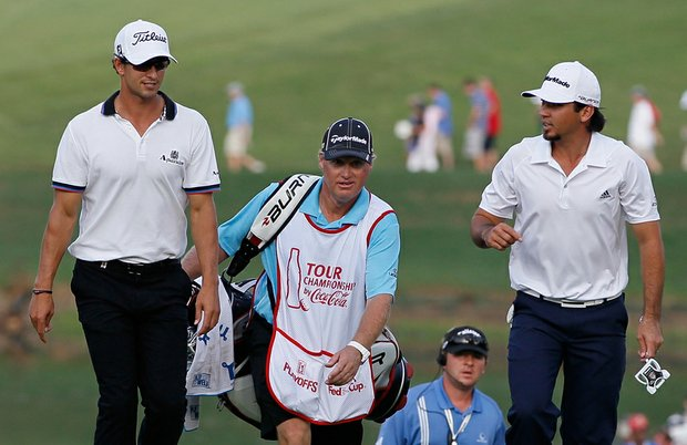 Jason Day, right, and Adam Scott walk to the 18th green during the second round of the Tour Championship at East Lake Golf Club.