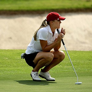 Alabama's Jennifer Kirby looks over her putt at No. 9.